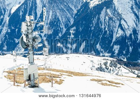 Photo of signal transmitter in the snowy mountains