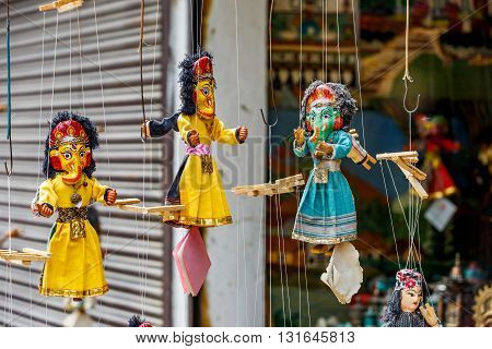 Photo of colorful marionette puppets for sale