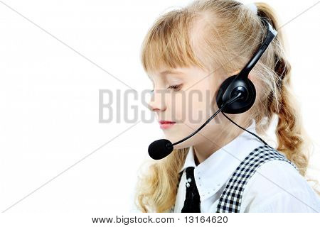 Shot of a little girl in headphones with microphone. Isolated over white background.