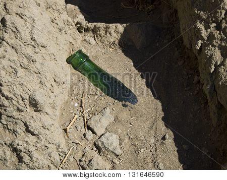 Empty beer bottle on the coast of Crimea