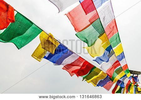 Close up photo of many colorful waving prayer flags