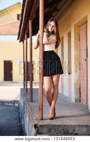 Long hair caucasian girl waiting. Outdoor portrait