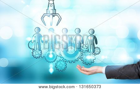 Human resources management and choice concept with businessman hand holding sketch on abstract blue background