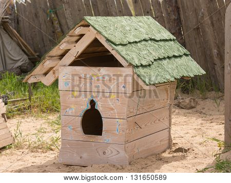 Stylized and decorated booth for the dog in the yard