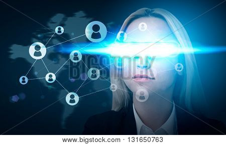 Social network concept witt busiesswoman wearing illuminated smart glass on blue background