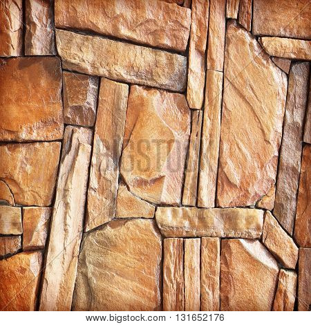 The modern slab slate stone wall background.