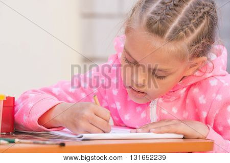 Schoolgirl Is Drawing In Pencil On The Album, In The Yard