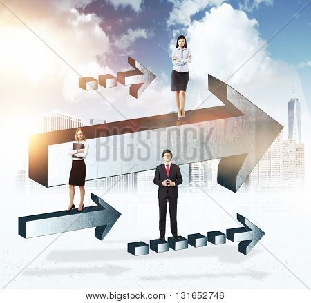 Success concept with businesspeople on grey arrows with sunlit city in the background