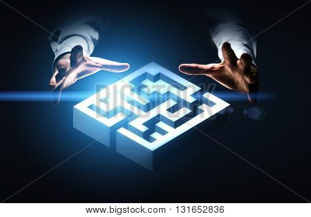 Business challenge concept represented by hands grabbing abstract illuminated maze