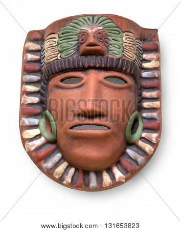 Indian Mayan Aztec ceramic painted mask with feather isolated on white with clipping path