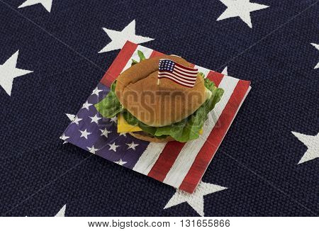 Hamburger on an American flag napkin with toothpick - star place mat background