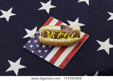 Hotdog on an American flag napkin with toothpick - star place mat background