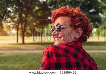 Outdoor portrait of a fifty year old woman