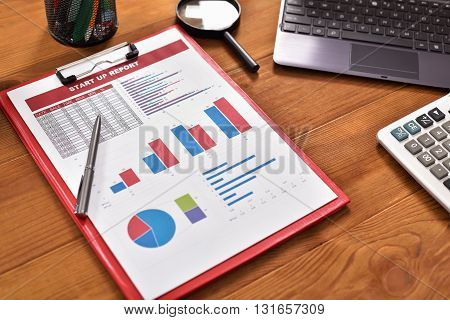 Start up report with graphs and tables on table