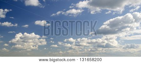 White clouds flying in the endless sky natural background