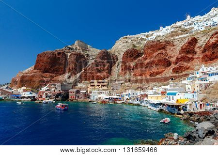 Old Port in the village Oia on Santorini island in the Aegean Sea. Greece.