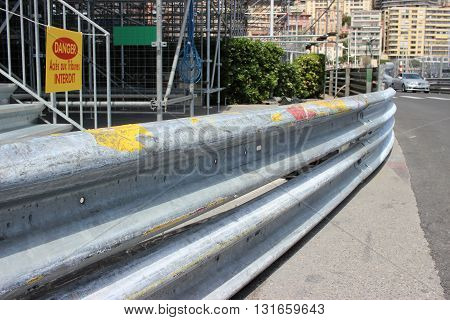 Monte-Carlo Monaco - April 28 2016: Monaco Grand Prix 2016 - Safety Barrier Fence Racing on Asphalt Road in Monte-Carlo Monaco