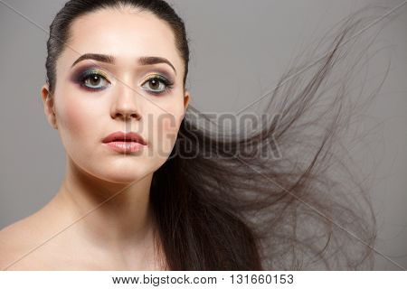 Beautiful brunette woman with long hair.