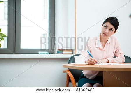 Woman Writing in paper.