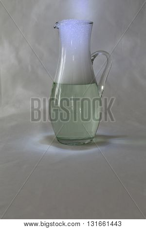 A jug with water and foam with a textured background