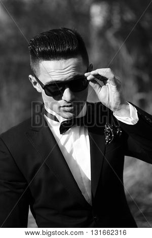 Handsome Man In Suit And Sunglasses