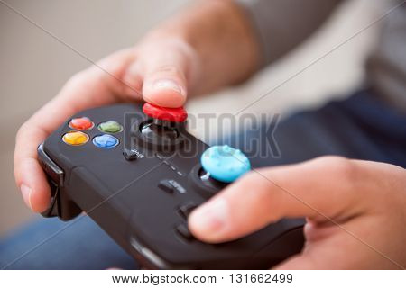 A real gamer. Hands of a man holding a joystick of a game console