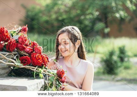 Little Girl With Red Roses
