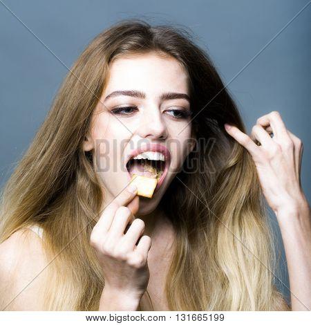 Smiling Girl Eating Crackers