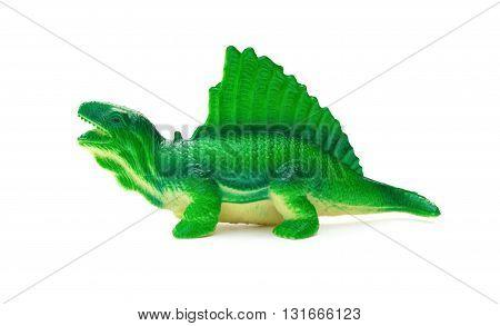side view green dimetrodon toy on a white background