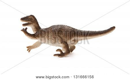 side view brown plastic dinosaur toy on a white background