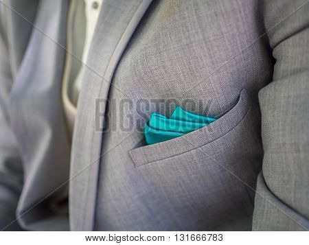 Grey suit with hints of blue accents
