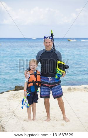 Young Family Snorkeling together in the Ocean at a tropical island resort
