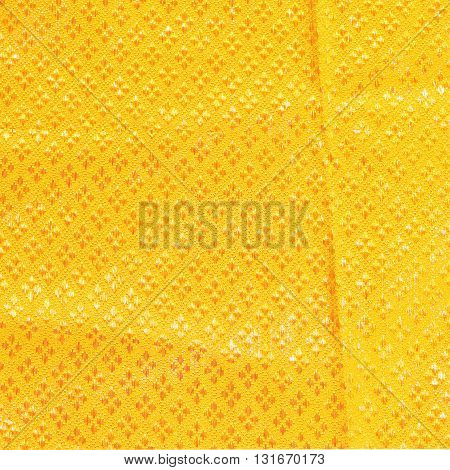 The gold fabric silk for background. gold fabric silk pattern
