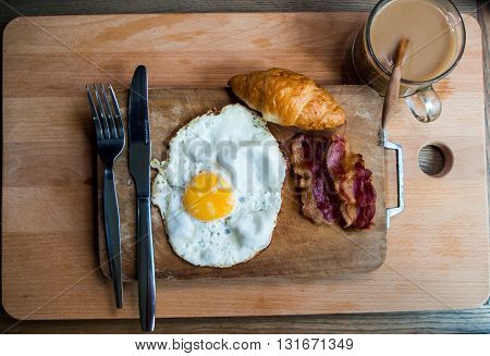 Breakfast With Croissants, Bacon, Eggs Claire Hot Coffee On A Wooden Tray.