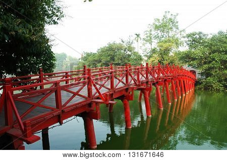 Huc Bridge spanning the Ngoc Son Temple Hanoi Vietnam with curved bridge architecture crawfish red symbolizes capital region thousands of years civilization god temple tortoises enters Vietnam history
