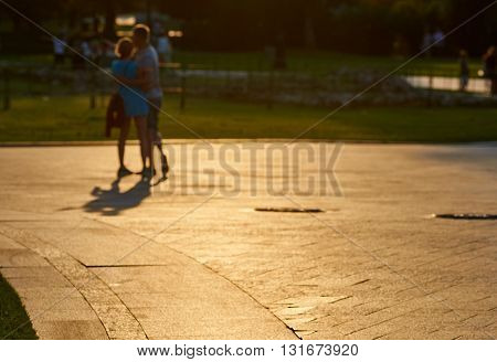 Loving couple at sunset. Blurred picture  Background.