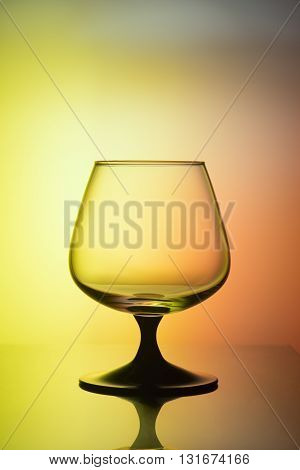 Empty glass for wine on a bicolor background