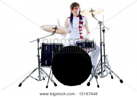 Rock drummer is playing his instruments. Shot in a studio.