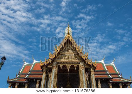 Top of the temple of Emerald Buddha inside the Grand Palace of Bangkok. Architectures inside the Palace, especially the temples are amazing. Moreover, the clear, blue sky charms the beauty more.