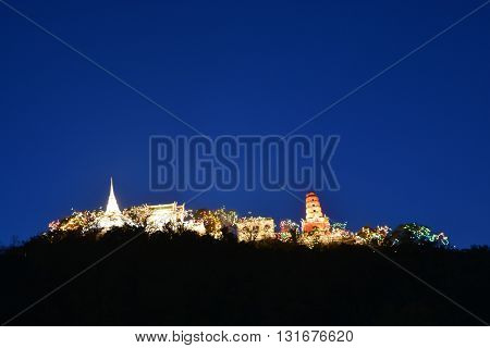 Khao Wang(Phra Nakhon Khiri Historical Park Holy City Hill) Old King Palace in this view is Phra That Jom Phet with Wat Phra Kaew Phra Sutasen Chedi Chedi Dang pagoda and Petchaburi city Thailand