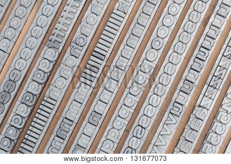 Arrangement of letterpress lead letters in row