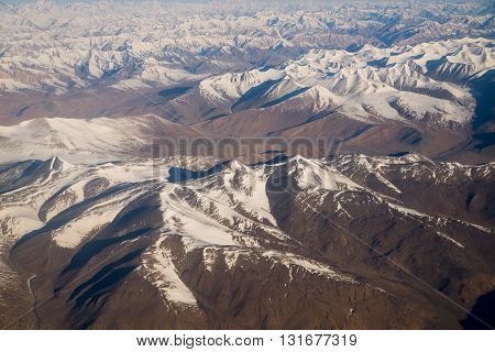 Snow mountains range near Himalaya in Ladakh, India (view from airplane)