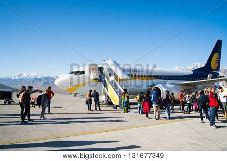 LADAKH, INDIA - APRIL 30, 2016: Passengers get out from Jet Airways airplane.
