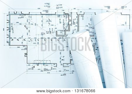 Architects Work Table With Blueprint Rolls And Technical Drawings