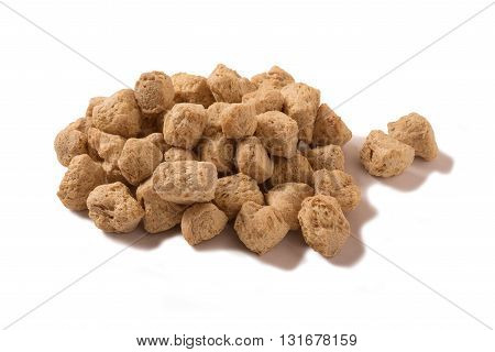 Soya chunks isolated on a white background.