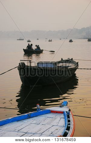 Boats on the Ganges River by the ghats in Varanasi India