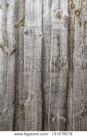 Part of the fence of the old wooden planks