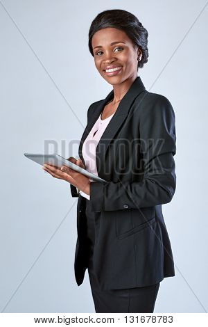 beautiful black african woman using digital tablet computer in corporate office attire
