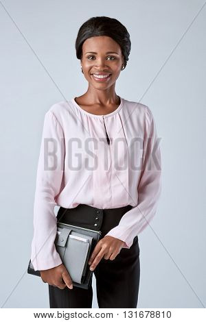 Beautiful black african corporate business woman holding  organiser portrait