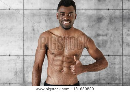 Isolated Headshot Of Healthy Muscular Dark Skinned Man With Beautiful Athlete Body Posing Shirtless